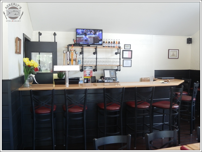 Enjoy a glass of wine or a local brew at our custom-built bar.